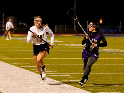 Mars' Mara Fuller (12)  pushes down field against Plum's Megan Franzi (9). Seb Foltz/Butler Eagle
