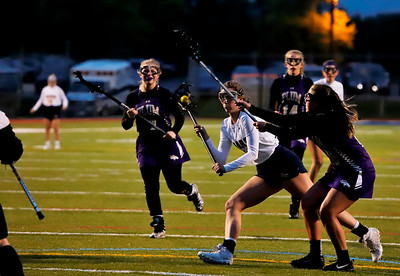 Mars junior Mara Fuller (#12) fires a shot past a plum defender. Seb Foltz/Butler Eagle