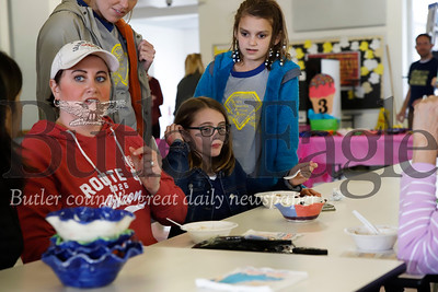Kalin Burek (center) enjoys some icecream at Butler Middle Schools Open Bowls event with her mom Lisa (left) Burek grandma Karol Halin (not pictured), brother Konner (not pictured) and Addison Geibel (right). Sixth graders made bowls in art class for the event.  Seb Foltz/Butler Eagle