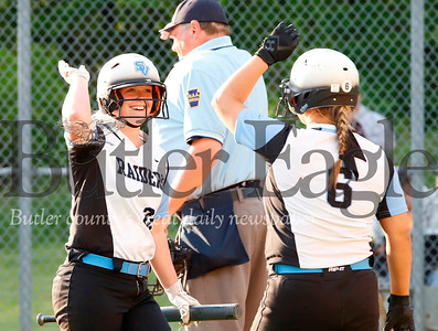 Maura Pasquale#21  high fives teammate Karli Hacker#6 after scoring a run. (Pasquale scored) Seb Foltz/Butler Eagle
