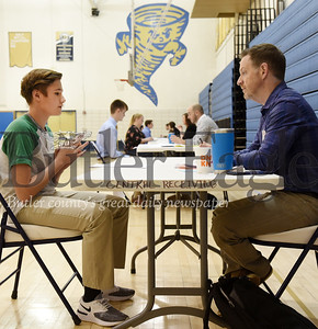 Harold Aughton/Butler Eagle: Butler 11th grader, Zachary Maroni, discusses his career plan with Dr. James Mortimer of Next Generation Pediatrics.