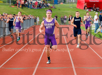 Karn City's Hunter Jones crosses the finish with a large lead to finish first in the 400 meter. Seb Foltz/Butler Eagle