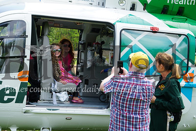Photo by J.W. Johnson Jr. Lily and Lizzie English pose for a photo taken by Mike English while sitting in a medical helicopter Saturday at the annual Big Truck Day in Zelienople Community Park.