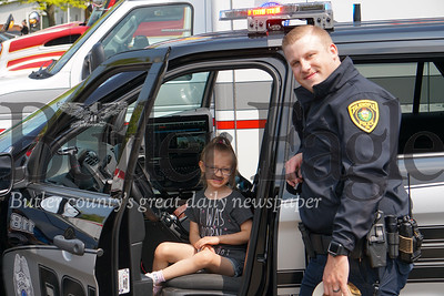 Photo by J.W. Johnson Jr. Olivia Borkovic and Zelienople police Patrolman Bret Myers pause for a photo Saturday at the annual Big Truck Day in Zelienople Community Park.