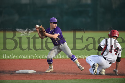 Karns City second baseman Conner Schaffner beats Moniteau's Lee Dematties to second to turn a double play. Seb Foltz/Butler Eagle