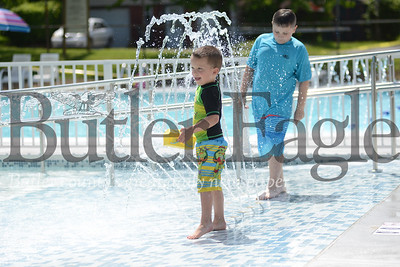 Carter Rubinosky plays in the sprinklers at the newly renovated pool at EDCO Park.