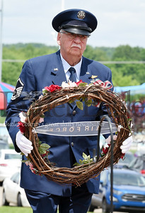 Harold Aughton/Butler Eagle: Chuck Lewis carries a wreath in memory of those who served in the Air Force during the Memorial Day ceremony held at the North Boundary Park in Cranberry Twp. Sunday, May 26.