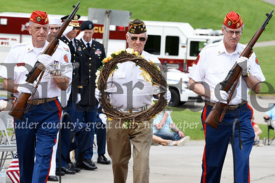 Harold Aughton/Butler Eagle: Bill Dinning of the VFWPost 879 presents a wreath in memory of those who served in the Army during the Memorial Day ceremony held at the North Boundary Park in Cranberry Twp. Sunday, May 26. Dinning is accompainied by Gary Farole (on left) and Ray Tedford of the Marine Corp. League of the Ohio Valley Detachment 882.