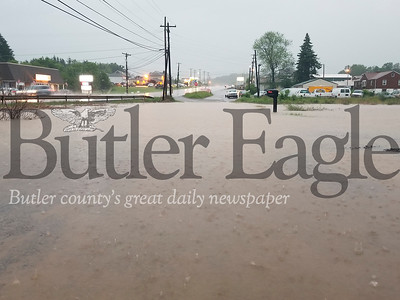 Old Route 8 was flooded near Hunter Truck Sales. Photo by Nathan Bottiger