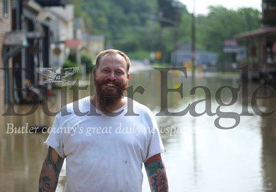 Josh Meeder, Center of Harmony owner, is pictured here in front of his flooded properties in Harmony. He said most of the flooding in the borough is caused by damaged drainage lines that redirect flood waters to Mercer Street.