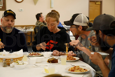 Harmony volunteer firefighters Steven(left), Jill, and Zach Madaffari enjoy a free dinner at Grace Church of Harmony Wednesday along with Steven and Jill's nephew Cody Kopelic. Church volunteers put on the dinner in the aftermath of Tuesday night's floods. Seb Foltz/Butler Eagle