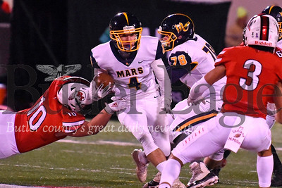 Mars wide reciever Zach Schlegel pushes past Peters Township 's Corban Hondru for a short gain after a reception on the Planet's opening drive in the second half. Seb Foltz/Butler Eagle
