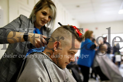 Jay Grassel of Butler gets a free haircut from a Great Clips stylist at the Butler County Stand Down event Friday. Seb Foltz/Butler Eagle