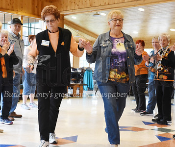 Harold Aughton/Butler Eagle: Connie Collier,70, and Katie Double, 84, of the Chicora Senior Center promenade during the square dance at the YMCA CAMP Kon-O-Kwee Wed., Oct. 30.
