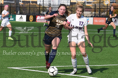 Mars' Taylor Hamlett challenges Plum's Kaitlyn Patton for a ball in the first half of Saturday's WPIAL Class 3A Championship Saturday at Highmark Stadium in Pittsburgh. Hamlett contributed two goals in th Planets 4-0 championship win. Seb Foltz/Butler Eagle