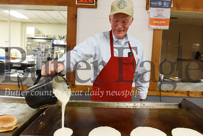 Harold Aughton/Butler Eagle: Al McGrath of Butler volunteered making pancakes during election day at Tangelwood.