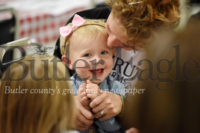 Harold Aughton/Butler Eagle: Mackenna, 1, of Butler plays patty cake with her mother, Amanda Shingleton, during the pancake fundraiser at Tangelwood, Tues., Nov. 11.