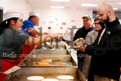 Natalie Johnston serves up pancakes to Alex Scialabba of Butler Tuesay evening. For a number of voters like Scialabba, the Rotary's annual Pancake Breakfast became a pancake dinner Tuesday evening. Seb Foltz/Butler Eagle