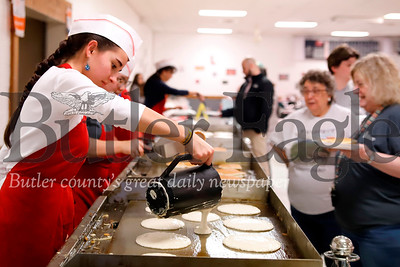 Rotary volunteer Grace Wahl of Butler pours fresh pancakes on to a skillet at the Rotary Pancake Breakfast Tuesday Evening. The all day event became a pancake dinner for the after work voting crowd. Seb Foltz/Butler Eagle