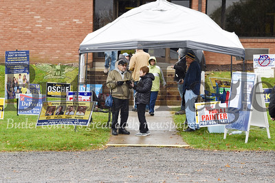Harold Aughton/Butler Eagle:  Retired pastor Nick Protos speaks with Carol Robinson of Middlesex Twp. outside the polling station Tues., Nov. 11.