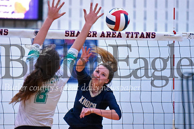 Knoch's  Skylar Burkett (9) spikes it past South Fayette's Isabella Franjione during Tuesday night's playoff match at Shaler High School. Knock topped South Fayette 3-0. Seb Foltz/Butler Eagle