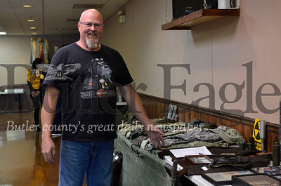 GGordon Kennedy is displaying his collection of military gear at the American Legion Post 117 hall on Monday. Tanner Cole/Butler Eagle
