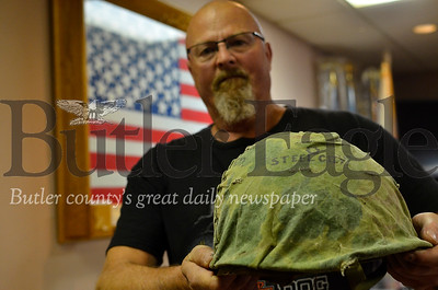 Gordon Kennedy holds a Vietnam War-era helmet that he's displaying at the American Legion Post 117 hall. Tanner Cole/Butler Eagle