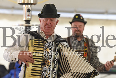 Karl Lukitsch of the Pittsburgh-based German-style band Autobahn plays the accordion for attendees of the Harmony christmas market Saturday. Seb Foltz/Butler Eagle