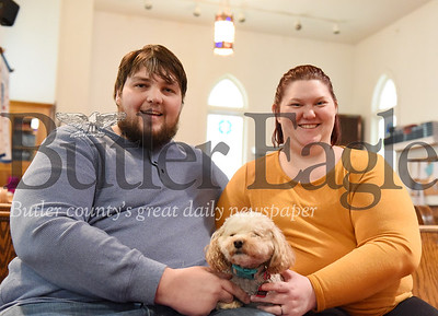 Harold Aughton/Butler Eagle: Zach and Jenny Martin with the Toy Poddle, Abbey.