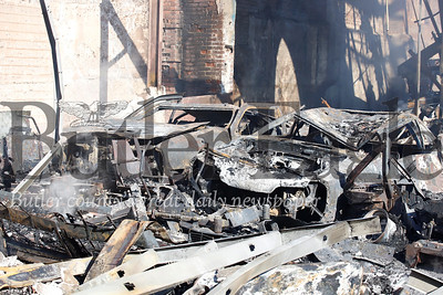 Shells of a 1986 Ford Thunderbird Supercoup (left) and 88 Ford Mustang GT in the workshop destroyed in the secondary fire Saturday morning. Seb Foltz/Butler Eagle