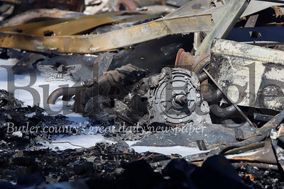 A burnt engine parts from the workshop destroyed in the second fire Saturday morning. Seb Foltz/Butler Eagle