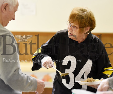 Harold Aughton/Butler Eagle: Volunteer Rosemarie Meyer, 76, of Saxonburg serves Ed Stephens, 87 of Sarver, during the Thanksgiving celebration at the Southeast Senior Center, Thurs., Nov. 14, 2019.