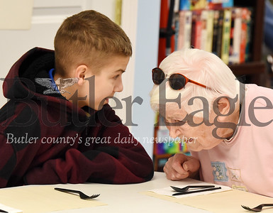 Harold Aughton/Butler Eagle: Eric Zacherl, 14, of St. Gregory's Catholic School, strikes up a conversation with Grace Thornton, 91, of Newhaven Court, Tues., Nov. 19, 2019.