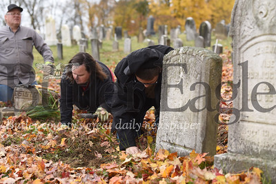 Greyson Jones, 14, clears dirt around the base of a fallen tombstone in the Harmony Mennonite Meetinghouse  Cemetery.jones and three other scouts from Boy Scout Troup 1606 worked on fixing up the cemetary for their Eagle Scout projects. Seb Foltz/Butler Eagle