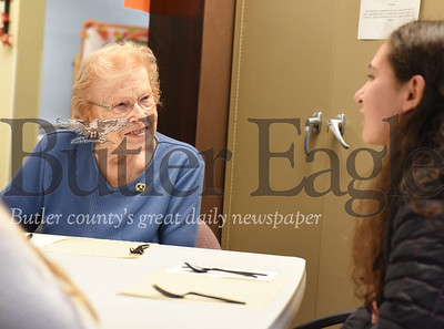 Harold Aughton/Butler Eagle: Ada Spithaler, 92, of Newhaven Court listens to Sophia Signoriello, 13, of St. Gregory's during a Thanksgiving celebration, Tues., Nov. 19, 2019.