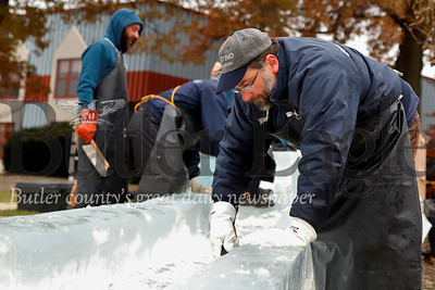Rob Higareda and a work crew from of DiMartino Ice Company put the finishing touches on the ice slide being built for  for for Cranberry Township's Santa's First Stop Eagle North Pole Ice Festival Friday. Seb Foltz/Butler Eagle