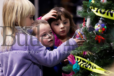 Isabella, 4, and Nicolas Rosenberger,3, and Macrina Deem, 4 check out the tree ornaments at the Cranberry Township Municipal Building Wednesday. 11/20/19 Seb Foltz/Butler Eagle