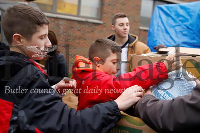 Grant Orday,11, unloads a turkey for donation at the Lighthouse Foundation with his brother Seth, 13, Tuesday. Seb Foltz/Butler Eagle 11/19/19