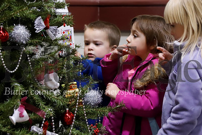 Nicolas Rosenberger,4; Macrina Deem, 4; and Isabella Rosenberger, 4, check out the tree ornaments at the Cranberry Township Municipal Building Wednesday. 11/20/19 Seb Foltz/Butler Eagle