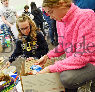 Harold Aughton/Butler Eagle: Sixth Graders from Mrs. Hovanick's class, left,  Ayla Werner, 12, and Emily Cornish, 12, prepare care packages for soldiers stationed abroad.