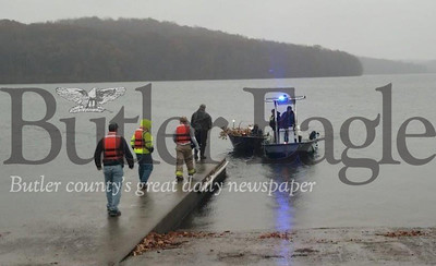 im Smith photoRescuers walk down the Route 528 boat launch at Moraine State Park to help a 14-year-old boy off his wind-swept boat after the teen was briefly stranded on Lake Arthur while  preparing to go duck hunting with his father. Park employees used their own boat (right) to reach the stranded boy and return him to shore. 3col pic only! Poor quality