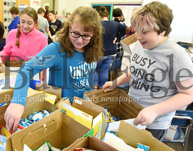 Harold Aughton/Butler Eagle:Sixth graders from Mrs. Hovanick class, Nicole Michel and Lucca Unik prepare care packages for U.S. soldiers stationed overseas.