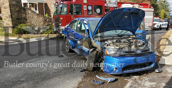A man was hospitalized after his Ford Focus crashed into a utility pole on Morton Avenue in Butler. Nathan Bottiger/Butler Eagle