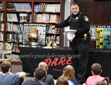 Butler County Sherriff Deputy  Anthony Sawl  speaks to Mrs. Garcia-Bish's  5th grade class during the D.A.R.E. graduation ceremony at St. Lukes Elementary, Mon., Nov. 25, 2019. The 10-week program was funded by the Butler County Human Services. Delaney Frye won first place for her essay, while siblings Connor Crotzer took second place and his sister, Olivia Crotzer on third place for their essays.