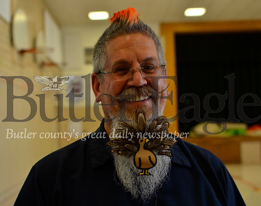 "Ray Gonzalez, lead custodian at Emily Brittain Elementary School, decorates his beard for all the major holidays. Students love it, he said. ""I just hope it comes out by Thanksgiving,"" Gonzalez said Tuesday. Tanner Cole/Butler Eagle"