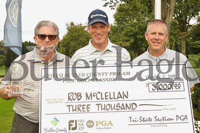 Pro Am pro winner Rob McClelland (center) with Butler County Tourism & Convention Bureau president Jack Cohen (left) and Tri-State PGA executive director David Wright.