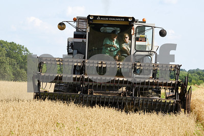 Harold Aughton/Butler Eagle: Guy Daubenspeck teaches Emily Zang how to operate the combine.