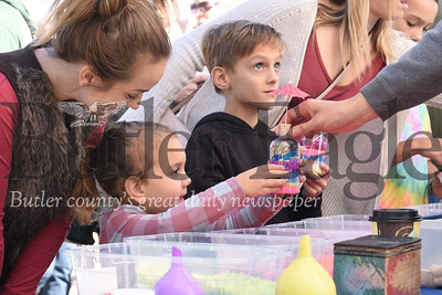 Kids construct sand art projects at Mars' Apple Fest Saturday. Seb Foltz/Butler Eagle