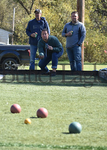 Gina Andreassi, of Pittsburgh, intently eyeballs her shot during the annual Bocci Ball tournament at the East Brady Sons of Italy hall on Route 68. The Karns City native returned home to Butler County for the hall's annual Columbus Day Celebration. More than 60 people participated in the all-day tournament. Looking on were her opponents, East Brady residents Dan Slaugenhoup and Todd Lucas. Andie Hannon/Butler Eagle