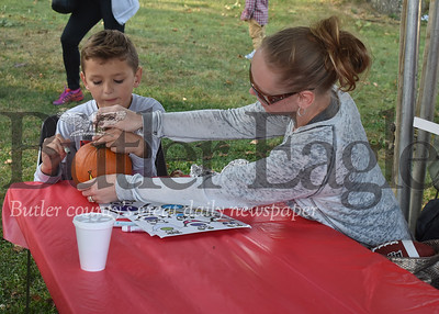 Nine-year-old Landon Phillips and his mom, Jessica Bisignano, worked together to paint and decorate a pumpkin during the annual Oktoberfest celebration at Concordia Lutheran Ministries in Cabot. The family just moved to Cabot from the Altoona area and were excited about all the free activities offered by festival organizers. They were among the hundreds who came out for annual event that featured a German band, German-themed food, pumpkin painting and other children's activities. ANDIE HANNON/BUTLER EAGLE